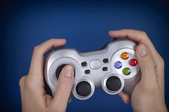 Young woman plays video game using a gamepad Stock Photo