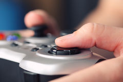 Young woman plays video game using a gamepad Stock Photos