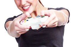 Young woman plays a videogame Royalty Free Stock Photos