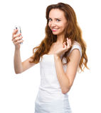 Young woman is pleased by incoming message Royalty Free Stock Photography