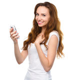Young woman is pleased by incoming message Stock Images