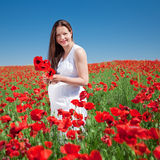 Young woman plucks flowers Royalty Free Stock Photo