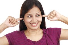 Young woman plugging ears with fingers Royalty Free Stock Image