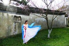 Young woman in the plum garden Stock Photos