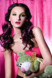 Young woman with the plush toy royalty free stock photography