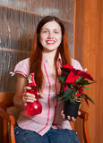 Young woman with Poinsettia flowers Royalty Free Stock Photos