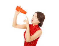 Young woman point to a empty red envelope Royalty Free Stock Photos