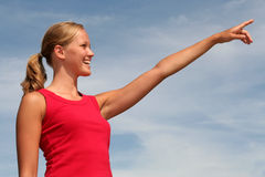 Young woman pointing Royalty Free Stock Image