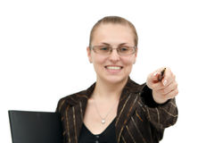 Young woman pointing. A young beautiful attractive woman poiting to us with a pen Stock Images