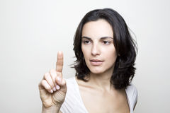Young woman pointing Stock Photography