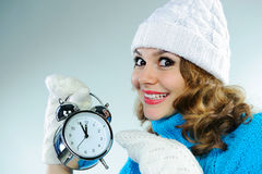 Young woman pointing on alarm clock Stock Photography