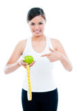Young Woman Pointing At Apple And Measuring Tape Royalty Free Stock Photo