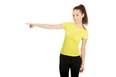 Young woman pointing aside. Stock Photography