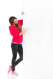 Young woman pointing at big white placard Royalty Free Stock Photography