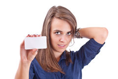 Young woman pointing at blank card in her hand Stock Photo