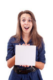 Young woman pointing at blank card in her hand Royalty Free Stock Photography