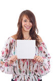 Young woman pointing at blank card in her hand Royalty Free Stock Image