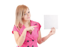 Young woman pointing at blank card in her hand. Portrait of young woman pointing at blank card in her hand against white background Stock Photography