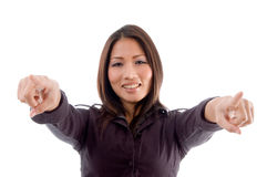 Young woman pointing with both hands stock photos
