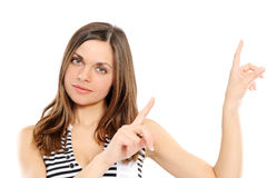 Young woman pointing at copy space Royalty Free Stock Photography