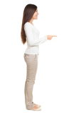 Young Woman Pointing At Copyspace Royalty Free Stock Images