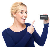Young Woman Pointing at a Credit Card Stock Images