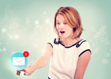 Young woman pointing at email icon Stock Image