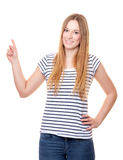 Young woman pointing with finger Royalty Free Stock Photos