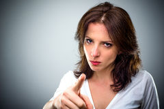 Young woman pointing a finger of blame Royalty Free Stock Photos