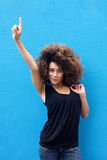Young woman pointing finger up. Portrait of young woman pointing finger up Royalty Free Stock Photography