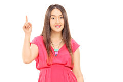 Young woman pointing with finger Royalty Free Stock Photography