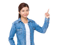 Young woman pointing finger upwards Stock Photography