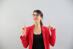 Young woman pointing fingers up Stock Image