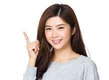 Young woman pointing her finger Stock Photography