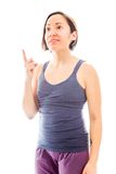 Young woman pointing her finger up Royalty Free Stock Images