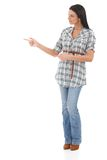 Young woman pointing and looking to the right Stock Photography