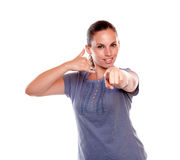 Young woman pointing-looking at you saying call me Royalty Free Stock Photos