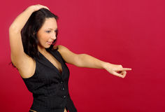 Young woman pointing over red Stock Photos