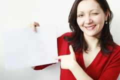 Young woman pointing a paper Royalty Free Stock Image