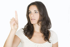 Young woman pointing on screen Stock Image