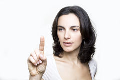 Young woman pointing on screen Royalty Free Stock Photography