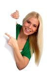 Young woman pointing at something interesting Royalty Free Stock Image