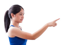 Young woman pointing at something Stock Photo