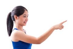 Young woman pointing at something Stock Images