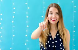 Young woman pointing at something royalty free stock photography