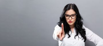 Young woman pointing something stock images