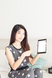 Young woman pointing on tablet Stock Photos
