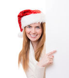 Young woman pointing to the blanc bo Royalty Free Stock Image