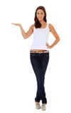 Young woman pointing to the side Royalty Free Stock Images