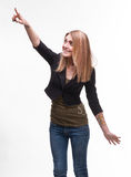 Young woman pointing to the side Royalty Free Stock Photography